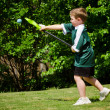 Child playing lacrosse at park — Stock Photo #10087254