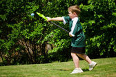 Child playing lacrosse at park — Stock Photo