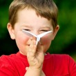 Child playing with paper airplane — Stock Photo #10163627