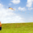 Child flying kite outdoors at park — Stock Photo #10226889