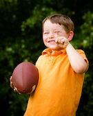 Child with football celebrating by showing that he's Number 1 — Foto de Stock