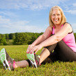 Middle-aged woman in her 40s stretching for exercise outdoors — Stock Photo #10248441