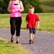 Mother and son jogging for exercise outdoors — Stock Photo #10248443