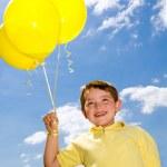 Happy child with balloons — Stock Photo