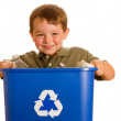 Recycling concept with young child carrying recycling bin isolated on white — Stock Photo #10412728