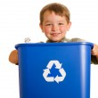 Recycling concept with young child carrying recycling bin isolated on white — Stock Photo #10423351