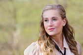 Outdoor portrait of beautiful blonde woman with space for copy — Stock Photo