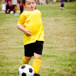 Young child boy playing soccer during organized league game — Stock Photo #10538924