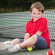 Portrait of young tennis player — Stock Photo