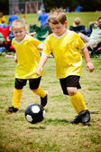 Children playing soccer in organized youth game — Foto de Stock