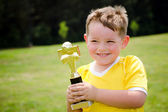 Young soccer player in uniform with his new trophy — Stock Photo