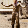 Performer covered in mud at Georgia Renaissance Festival - Stock Photo