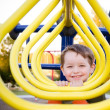 Cute preschooler playing at playground — Stock Photo