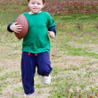 Young boy with football — Stock Photo