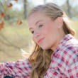 Outdoor portrait of beautiful blonde woman in western clothing — Stock Photo