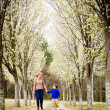 Stock Photo: Mother and son at park during spring with flowering trees