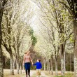 Stockfoto: Mother and son at park during spring with flowering trees