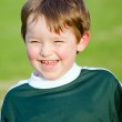 Portrait of happy young boy in soccer uniform — Stock Photo