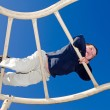 Young boy playing on playground — Stock Photo