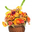 Fall color silk flower arrangement in basket isolated on white — Stock Photo #9677606