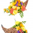 Thanksgiving flower arrangement in cornucopia basket isolated on white — Stock Photo