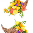 Stock Photo: Thanksgiving flower arrangement in cornucopia basket isolated on white