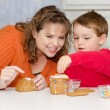 Mother and son build gingerbread house for Christmas — Stock Photo