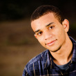 Portrait of African-American teenager outdoors at park — Stock Photo #9677678