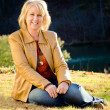 Fall portrait of happy middle-aged blonde woman — Stock Photo #9677691