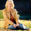 Fall portrait of happy middle-aged blonde woman — Stock Photo