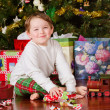 Stockfoto: Young boy unwrapping presents on Christmas morning
