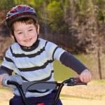 Boy riding bike — Stock Photo