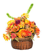 Fall color silk flower arrangement in basket isolated on white — Stock Photo