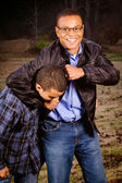 African-American father and son playing outdoors at park — Stock Photo