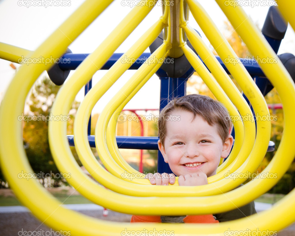 Cute preschooler playing at playground  Stock Photo #9677429