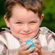 Boy holding easter egg — Stock Photo #9876859