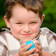 Boy holding easter egg - Stock Photo