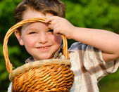 Boy looking through easter basket — Stock Photo