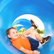 Cute young boy or kid playing in tunnel on playground. — Stock Photo