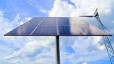 Solar panel and wind turbine — Stock Photo