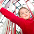 Young boy on playground during spring. — Stockfoto