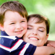 Spring portrait of mother and son on Mother's Day. - Foto de Stock