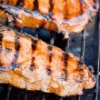 Juicy New York strip steak on gas grill. — Stock Photo #9906659