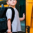 Boy in front of school bus — Stock Photo #9906896