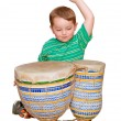 Young boy plays African bongo tom-tom drums, isolated on white background — Stock Photo