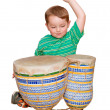 Young boy plays Africbongo tom-tom drums, isolated on white background — Stock Photo #9906926
