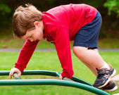 Young boy on playground during spring. — Stock Photo