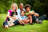 Portrait of mixed race family at park — Stock Photo