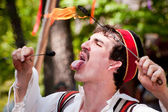 Fire eater at renaissance fair — Stock Photo