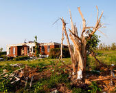 Tornado-damaged land and home in northern Alabama one month after storm. — Stock Photo